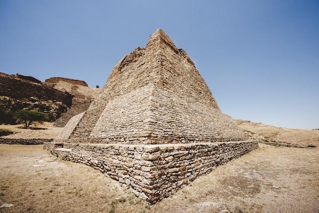 Beautiful shot of the la quemada zacatecas pyramid with a blue sky