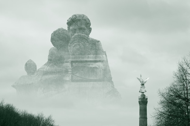 Beautiful shot of a large stone monument surrounded by fog