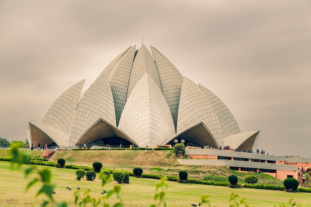 Beautiful shot of the lotus temple in delhi india under a cloudy sky Free Photo