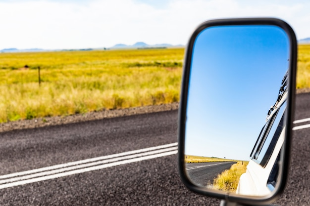 Beautiful shot of mirror of transport with a road view