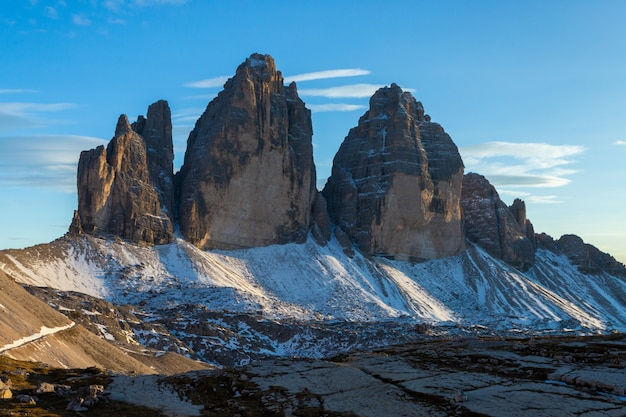 Beautiful shot of the mountain tre cime di lavaredo in italian alp under the shade of the clouds