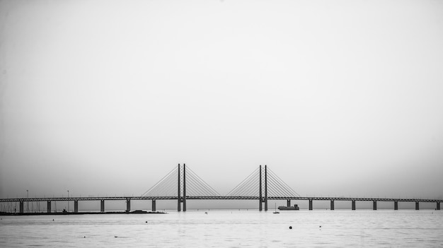 Beautiful shot of the oresund bridge in sweden enveloped in fog
