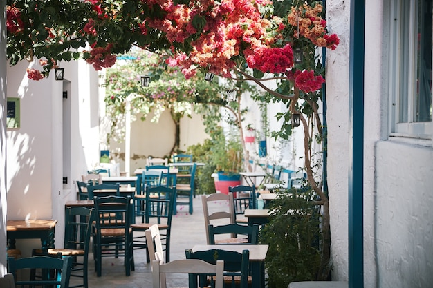 Beautiful shot of an outdoor cafe in the narrow bystreet in paros, greece