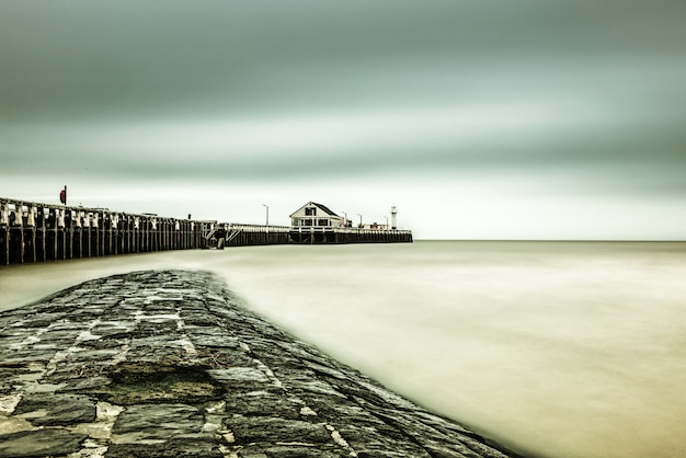 Beautiful shot of a pier near the sea under the breathtaking sky