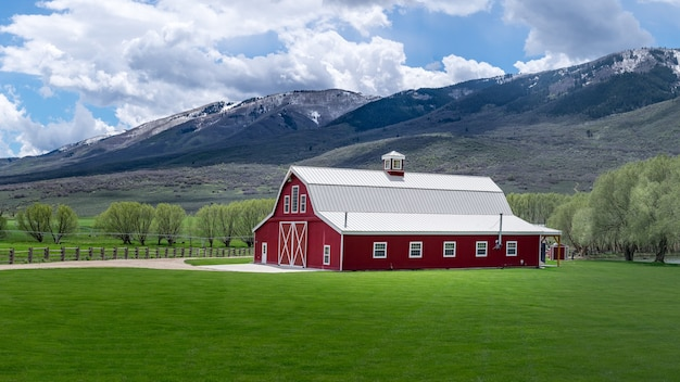 Beautiful shot of the red wooden barnyard in the field