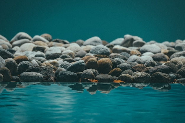 Beautiful shot of resting water reflecting the rocks