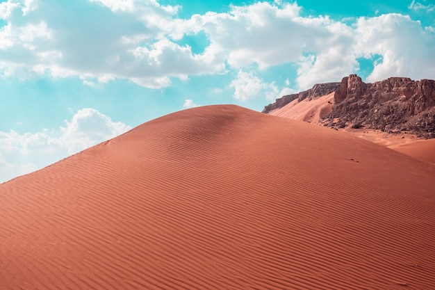 Beautiful shot of sand dunes under a bright sky on the desert in