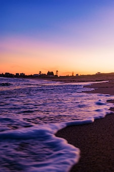Beautiful shot of scenery of sunset on the beach with a clear sky