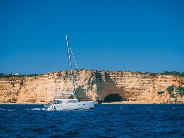 Beautiful shot of a ship at the algarve coast in portugal
