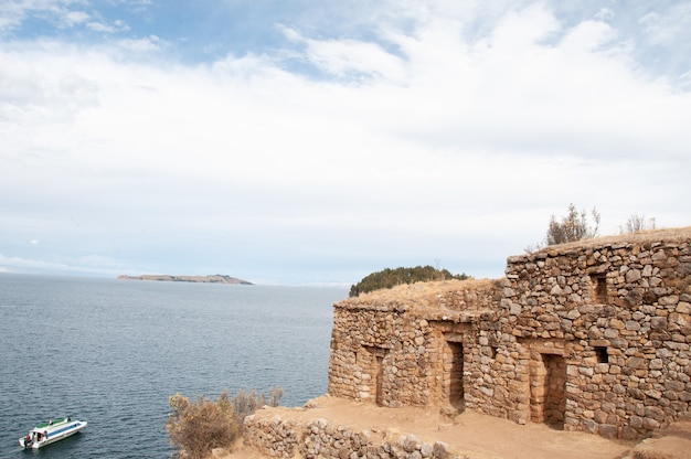 Beautiful shot of a stone building near the sea in bolivia