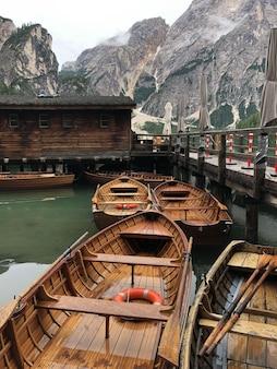 Beautiful shot of wooden boats on braies lake, on surface of dolomites, trentino-alto adige,   pa