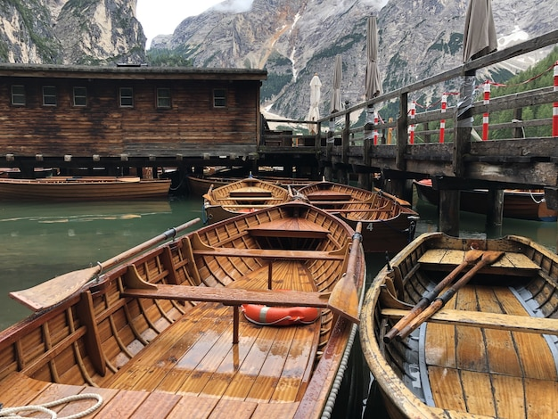 Beautiful shot of wooden boats on braies lake