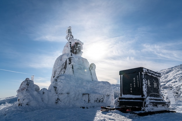 Beautiful silhouette scenic view of big buddha jizo statue on summit of zao mountain, yamagata, tohoku, japan