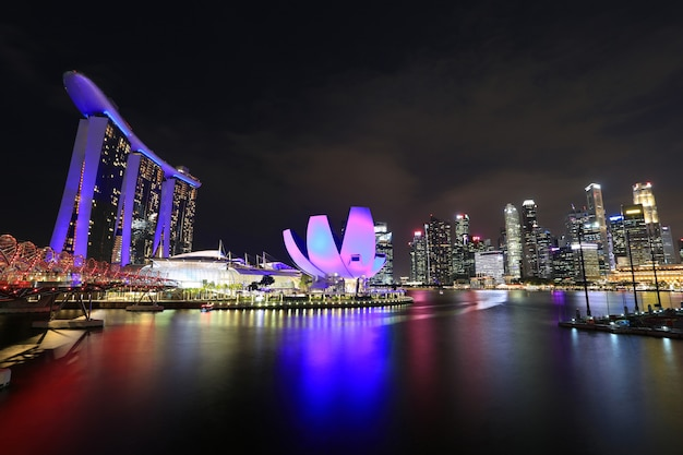 Beautiful of singapore skyline with urban buildings on over the night background
