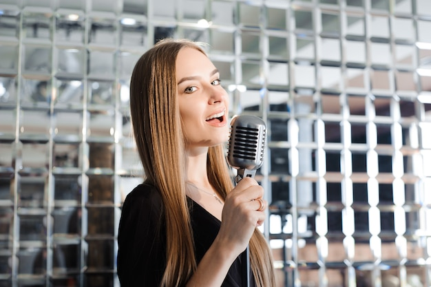 Beautiful singing girl. beauty woman with microphone. glamour model singer. karaoke song.
