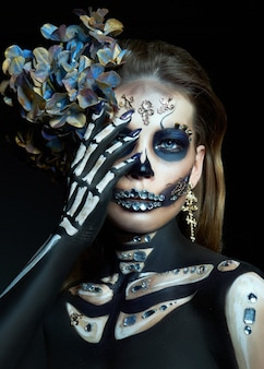 Beautiful skeleton woman with halloween makeup