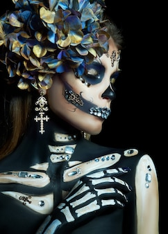 Beautiful skeleton woman with halloween makeup