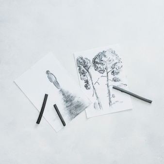 Beautiful sketches and charcoal pencil isolated on white background