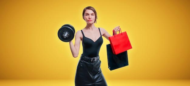 ダンベルとギフトバッグを持ってスタジオでポーズをとる美しいほっそりした女性。ギフトのコンセプト。ジムのメンバーシップ。ミクストメディア