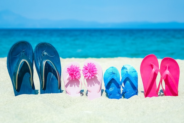 Beautiful slippers in the sand by the sea greece on nature background