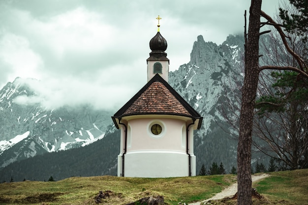 Beautiful small catholic church in the mountains of the bavarian alps