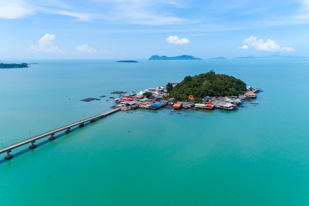 Beautiful small island in tropical sea with small bridge to the island located koh rat suratthani thailand
