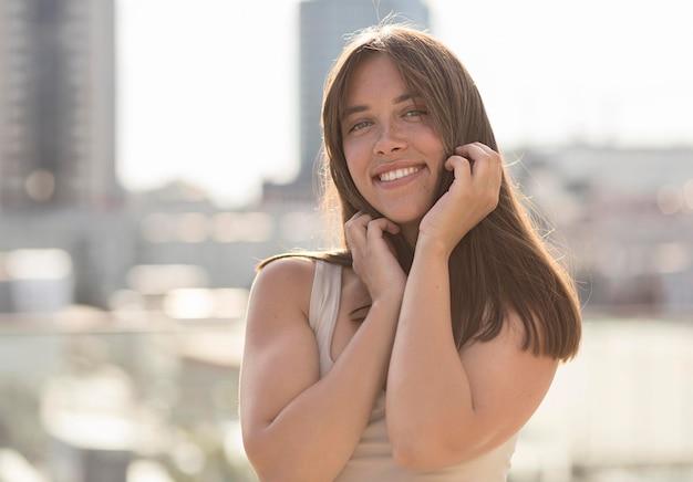 Beautiful smiley woman posing outside