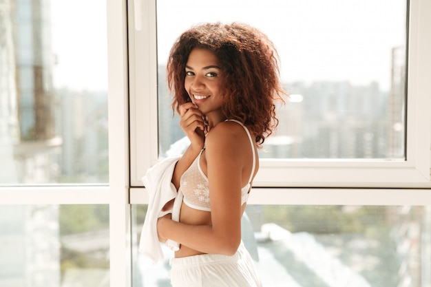 Beautiful smiling afro american woman in lingerie posing