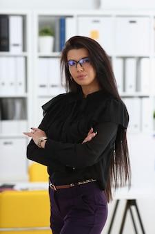 Beautiful smiling brunette woman in office