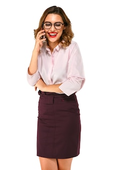 Beautiful smiling business woman having fun talking on smartphone, dressed up in blouse