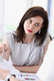 Beautiful smiling businesswoman portrait at workplace look away