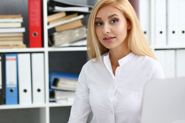 Beautiful smiling businesswoman at workplace