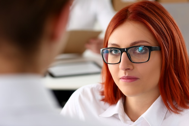 Beautiful smiling cheerful girl at workplace look