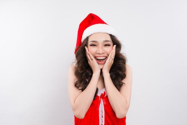 Beautiful smiling female asian model wear santa hat