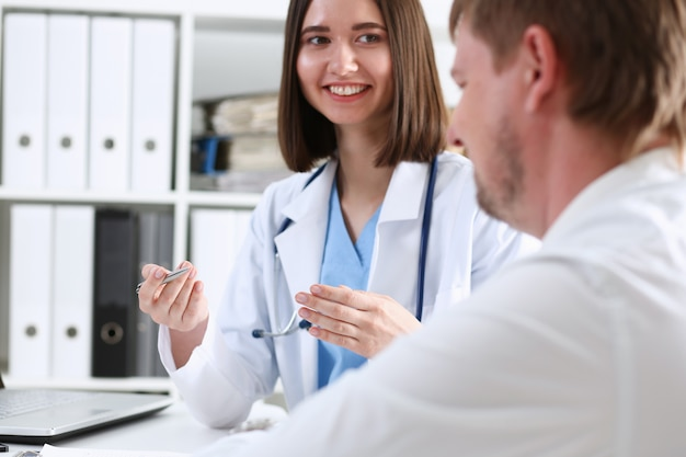 Beautiful smiling female doctor hold