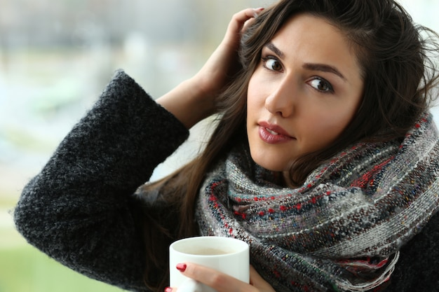 Beautiful smiling girl hold in arms cup portrait