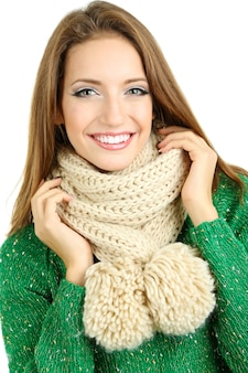 Beautiful smiling girl in warm knit scarf isolated on white