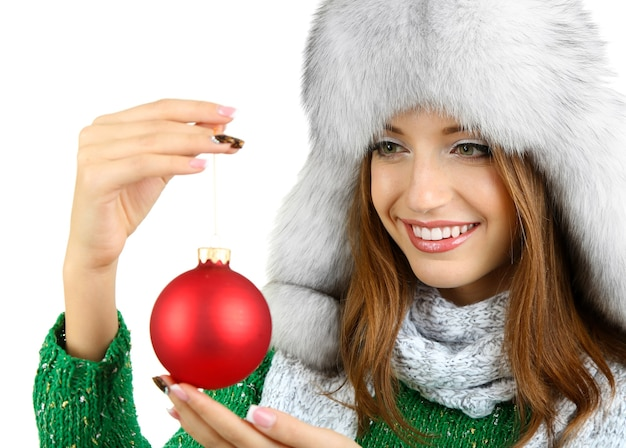 Beautiful smiling girl with christmas ball isolated on white