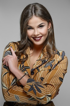 Beautiful smiling model in jacket with print. clean fresh face of pretty girl with natural makeup.