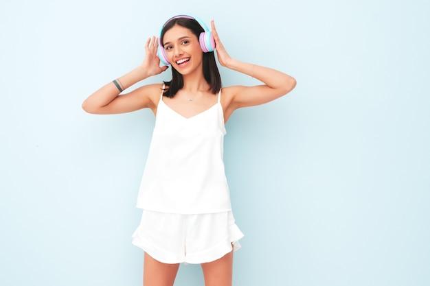 Beautiful smiling woman dressed in white pajamas