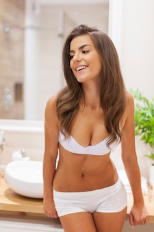 Beautiful and smiling woman in underwear