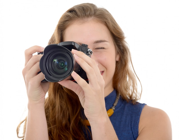 Beautiful smiling woman with digital camera, on white