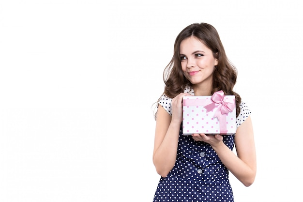 Beautiful smiling woman with gift box isolated on white.