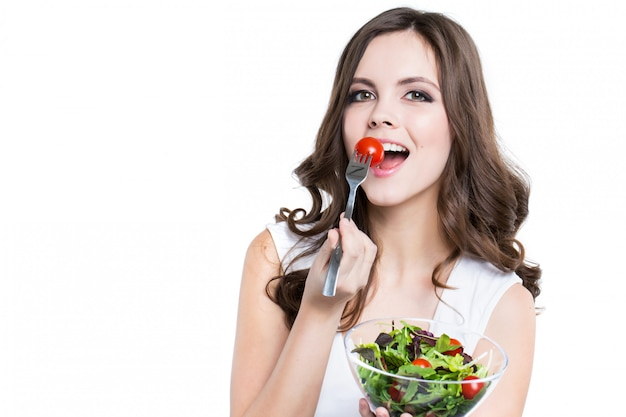 Beautiful smiling woman with salad isolated.