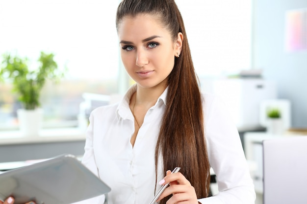 Beautiful smiling woman at workplace