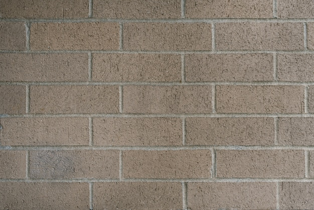 Beautiful smooth brick wall of gray-beige color. copy space background