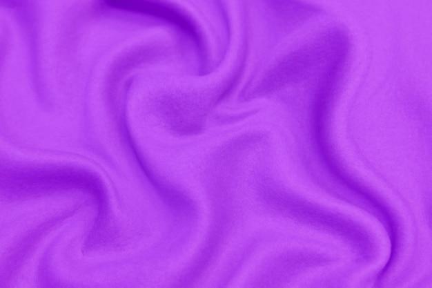 Beautiful smooth elegant wavy violet purple satin silk luxury cloth fabric texture, abstract background design.