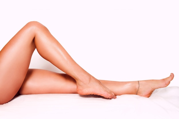 Beautiful smooth womans legs after laser hair removal on the colorful background