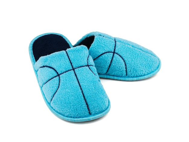 Beautiful soft home slippers blue color isolated on white background. comfortable home shoes.