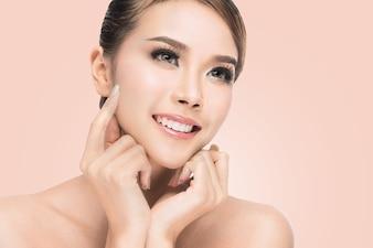 Beautiful Spa Asian Woman Touching her Face. Perfect Fresh Skin. Pure Beauty Model.
